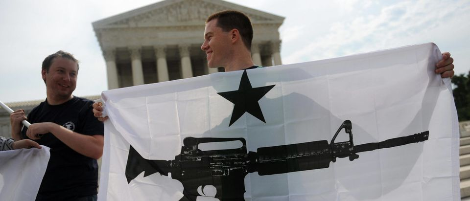 Gun rights activists celebrate at the Supreme Court after the D.C. v. Heller decision on June 26, 2008. (Tim Sloan/AFP/Getty Images)