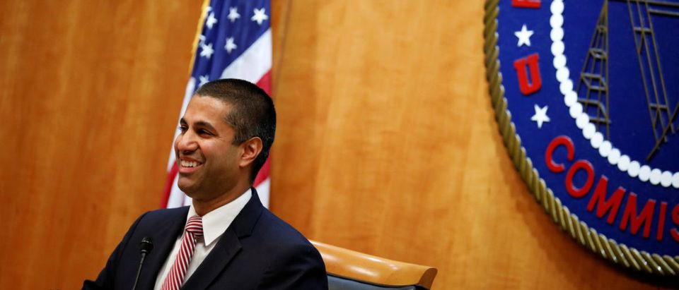 Chairman Ajit Pai speaks ahead of the vote on the repeal of so called net neutrality rules at the Federal Communications Commission in Washington, U.S., December 14, 2017. REUTERS/Aaron P. Bernstein