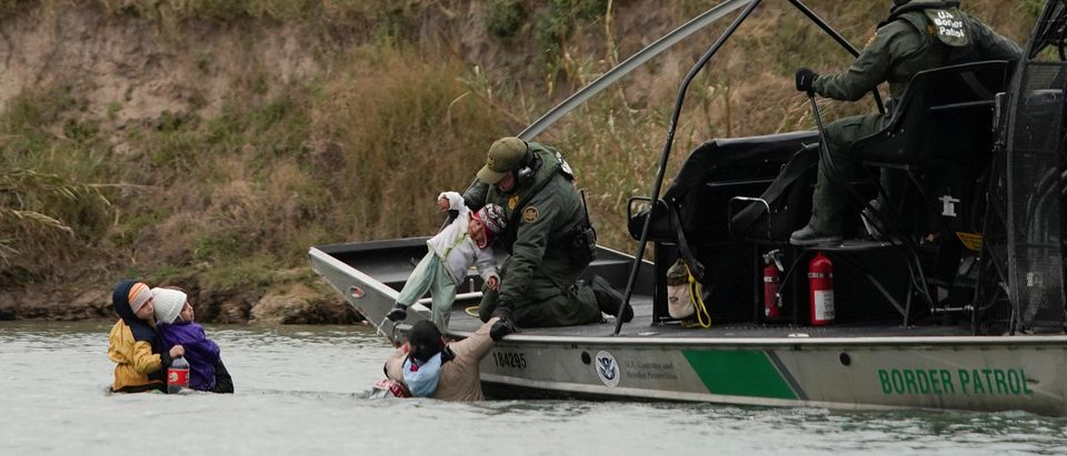 A U.S. border patrol boat rescues migrants crossing the Rio Bravo towards the United States, seen from Piedras Negras, Mexico, February 10, 2019. Picture taken February 10, 2019. REUTERS/Alexandre Meneghini