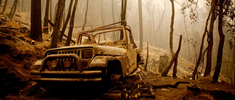 The remains of a home lies destroyed by wildfires in Green Valley Lake, California October 24, 2007. Firefighters made headway against 18 wildfires blazing across Southern California on Wednesday as hot winds abated for the first time in four days, but they were still battling to save entire neighborhoods from hopscotching flames. REUTERS/Max Whittaker (UNITED STATES)