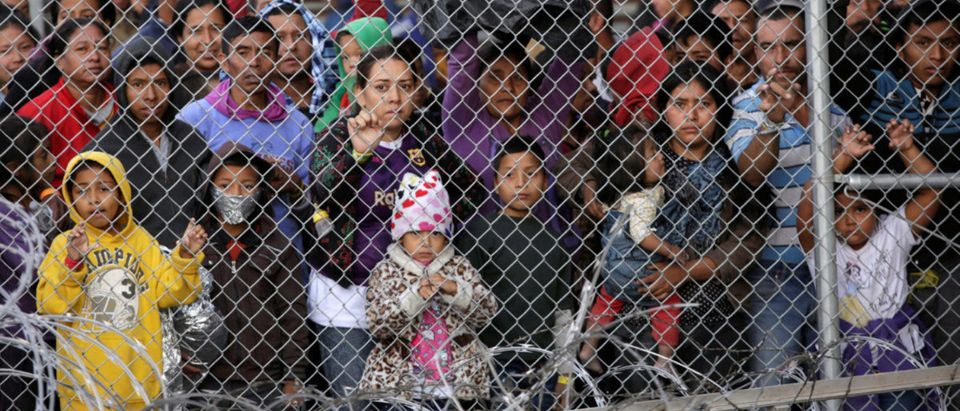 Central American migrants are seen inside an enclosure where they are being held after turning themselves in to request asylum, in El Paso