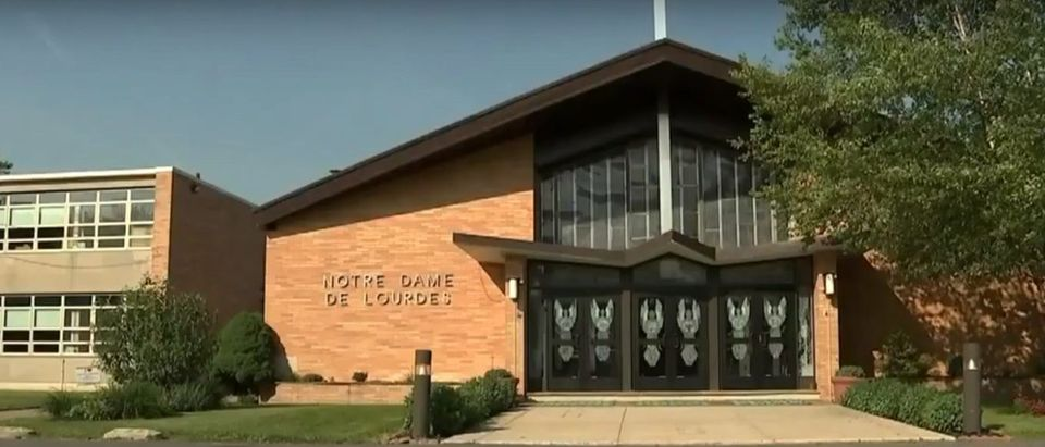 The Notre Dame de Lourdes parish church vandalized with pro-abortion graffiti (YouTube/CBS Philly)
