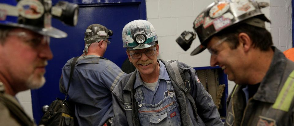 Miner John Antill speaks with colleagues as he starts his shift at the American Energy Corporation Century Mine in Beallsville, Ohio, U.S., November 7, 2017. REUTERS/Joshua Roberts