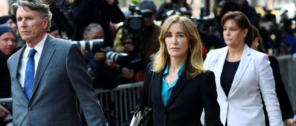Actor Felicity Huffman leaves the federal courthouse after facing charges in a nationwide college admissions cheating scheme in Boston, Massachusetts, U.S., April 3, 2019. REUTERS/Gretchen Ertl
