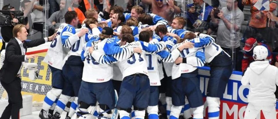 Finland's players celebrate winning the IIHF Men's Ice Hockey World Championships final between Canada and Finland on May 26, 2019 in Bratislava. (Credit: Photo by JOE KLAMAR / AFP/ Getty Images)