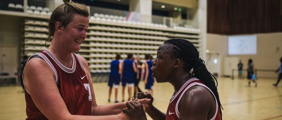 Ugandan transgender player Jay Mulucha (R) speaks with a teammate during the basketball competition at the 2018 Gay Games edition at the Palais des Sports Robert Charpentier in Issy- les-Moulineaux, south of Paris. (LUCAS BARIOULET/AFP/Getty Images)