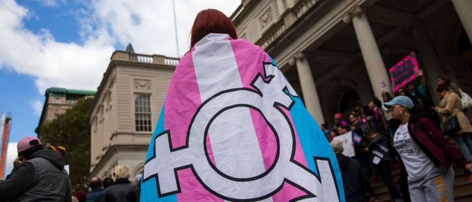 L.G.B.T. activists and their supporters rally in support of transgender people on the steps of New York City Hall, October 24, 2018 in New York City. (Drew Angerer/Getty Images)