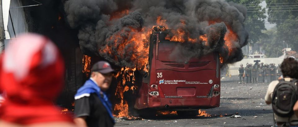 A bus burns down during a protest in the border city of Urena, Tachira, after President Nicolas Maduro's government ordered a temporary close-down of the border with Colombia on February 23, 2019. (JUAN BARRETO/AFP/Getty Images)