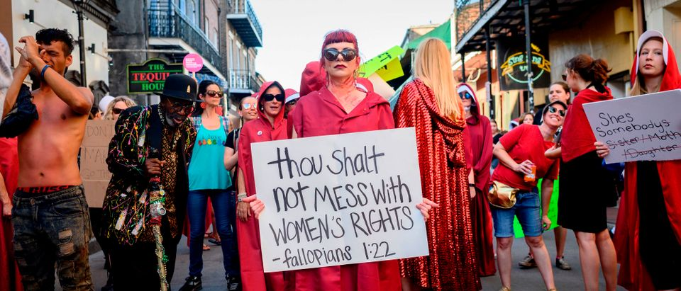 Handsmaid themed protesters march down Bourbon Street in the French Quarter of New Orleans, Louisiana, on May 25, 2019, to protest the proposed Heartbeat Bill that will ban abortion after 6 weeks in that state scheduled for a vote on May 28. (EMILY KASK/AFP/Getty Images)