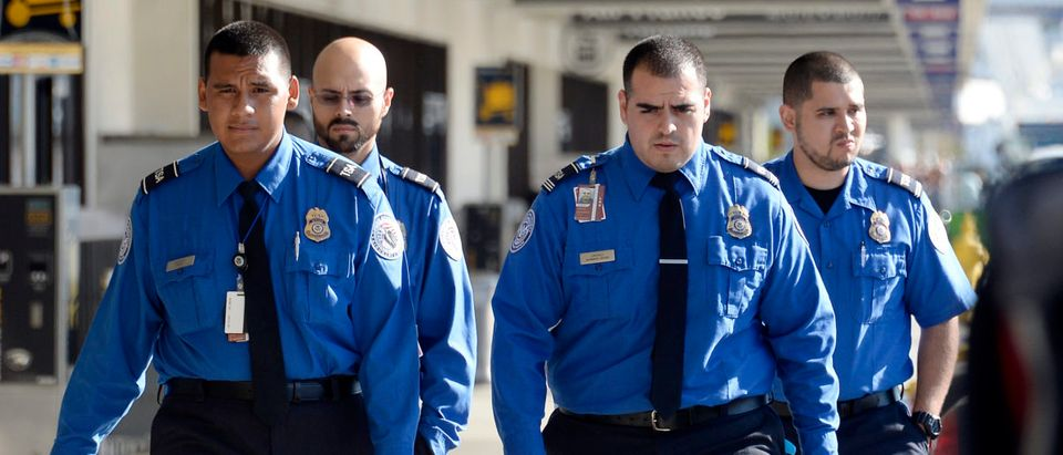 Transportation Security Administration agents walk on the departures level a day after a shooting that killed one Transportation Security Administration worker and injured several others at Los Angeles International Airport November 2, 2013 in Los Angeles, California. (Photo by Kevork Djansezian/Getty Images)