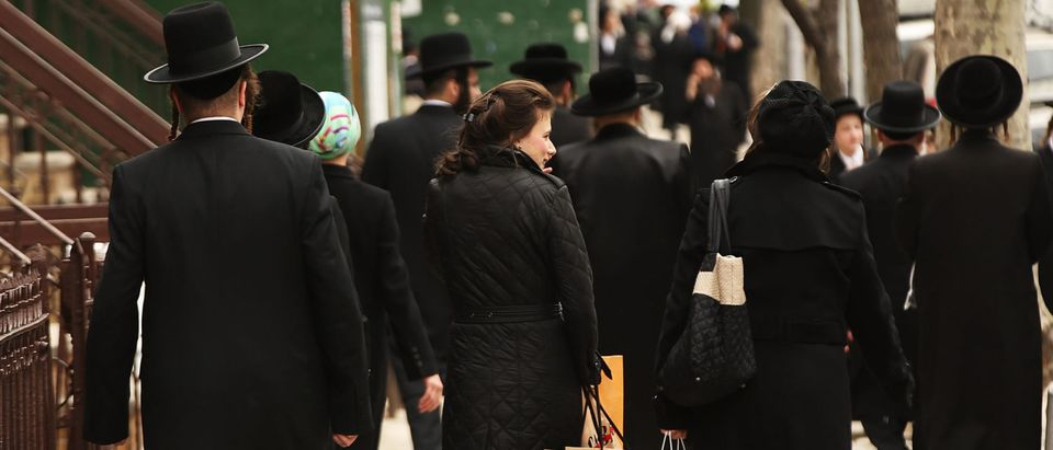 NEW YORK, NY - APRIL 24: Hasidic men and women walk through a Jewish Orthodox neighborhood in Brooklyn on April 24, 2017 in New York City. According to a new report released by the Anti-Defamation League (ADL), anti-Semitic incidents in the U.S. rose by 86 percent in the first three months of the year. The group's audit of anti-Semitic events counted 541 anti-Semitic attacks and threats in the first quarter of the year, a significant increase over the same period last year. (Photo by Spencer Platt/Getty Images)