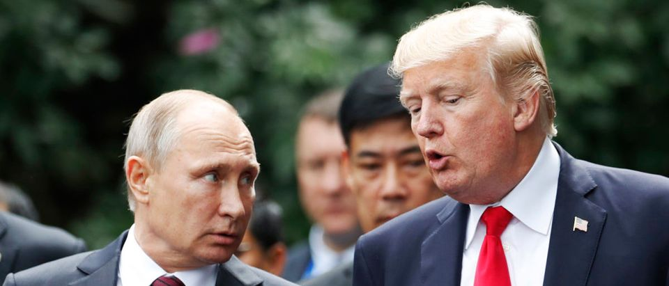 "US President Donald Trump (R) and Russia's President Vladimir Putin talk as they make their way to take the ""family photo"" during the Asia-Pacific Economic Cooperation (APEC) leaders' summit in the central Vietnamese city of Danang on November 11, 2017. (JORGE SILVA/AFP/Getty Images)"