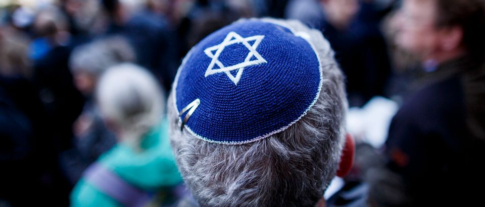 "A participant wears a kippah during a ""wear a kippah"" gathering to protest against anti-Semitism in front of the Jewish Community House on April 25, 2018 in Berlin, Germany.(Photo by Carsten Koall/Getty Images)"