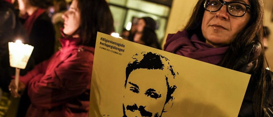 Activists of human rights organization Amnesty International hold a picture of Giulio Regeni and candles as they take part in a demonstration in front of Montecitorio, the Italian Parliament, in Rome on January 25, 2017, to mark the first anniversary since the disappearance of Italian student Giulio Regeni. (ANDREAS SOLARO/AFP/Getty Images)
