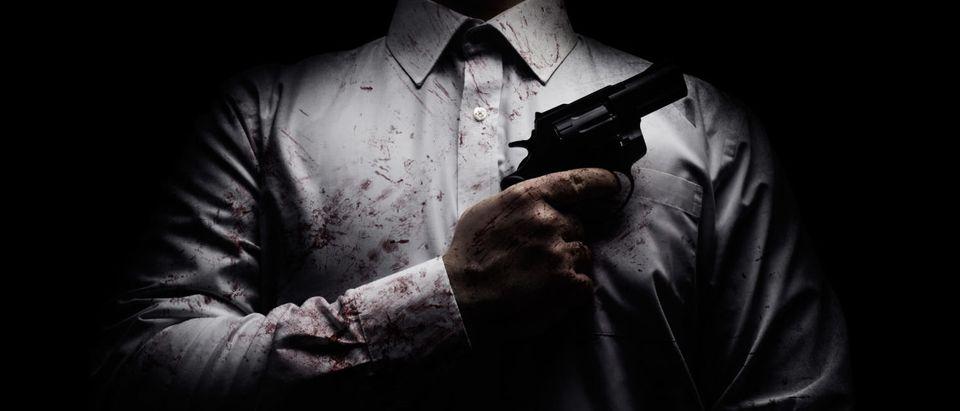A hit man is pictured. (Shutterstock/breakermaximus)