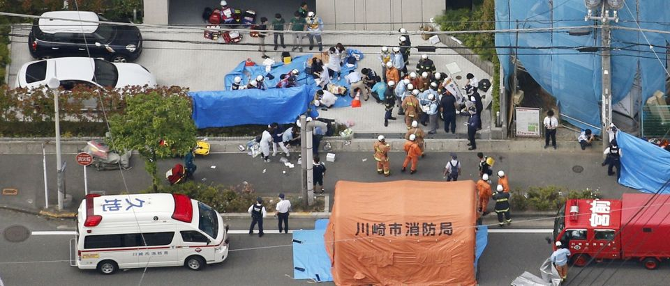 An aerial view shows rescue workers and police officers operate at the site where sixteen people were injured in a suspected stabbing by a man, in Kawasaki, Japan May 28, 2019. Photo by Kyodo/via REUTERS