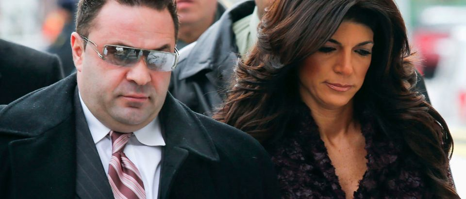 "Teresa Giudice, 41, (R) and her husband Giuseppe ""Joe"" Giudice, 43, (L) arrive at the Federal Court in Newark, New Jersey, March 4, 2014. ""Real Housewives of New Jersey"" cast members Teresa and Giuseppe are expected to plead guilty to charges stemming from their loan fraud case in which prosecutors say they lied on financial applications and hid income. REUTERS/Eduardo Munoz"