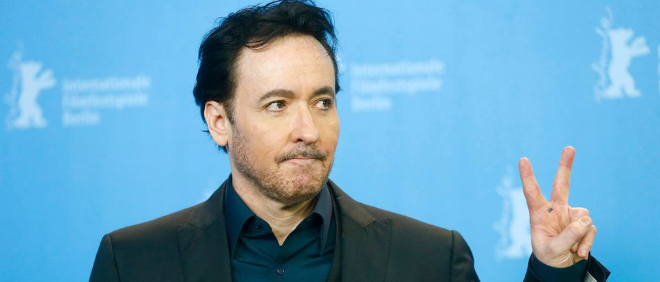 Actor John Cusack poses during a photocall to promote the movie 'Chi-Raq' at the 66th Berlinale International Film Festival in Berlin, Germany February 16, 2016. REUTERS/Hannibal Hanschke