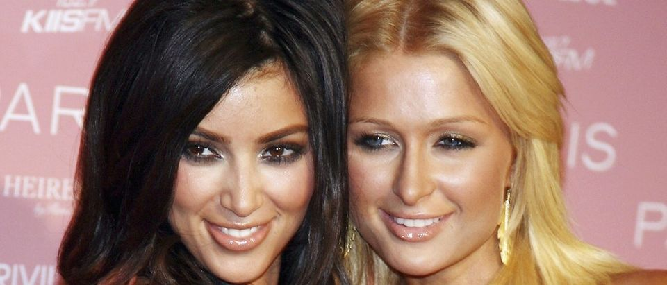 Socialite Kim Kardashian (left) and actress/singer Paris Hilton arrive at Paris Hilton's debut cd release party at Privilege on August 18, 2006 in Los Angeles, California. (Photo by Kevin Winter/Getty Images)