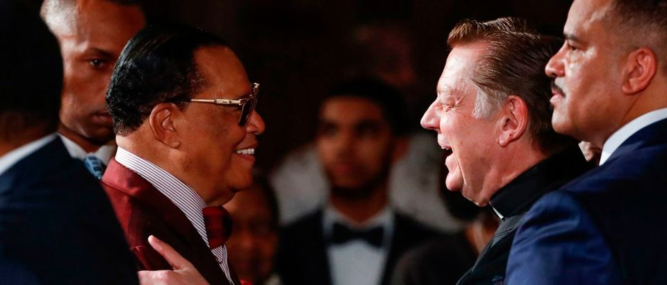 Father Michael Pfleger (R) greets Nation of Islam leader Louis Farrakhan (L) after they spoke at St. Sabina Catholic Church in Chicago, Illionis on May 9, 2019. (KAMIL KRZACZYNSKI/AFP/Getty Images)