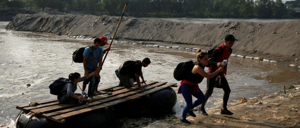 Migrants from Cuba en route to the United States, get off a raft as they crossed the Suchiate River from Tecun Uman, Guatemala to Ciudad Hidalgo