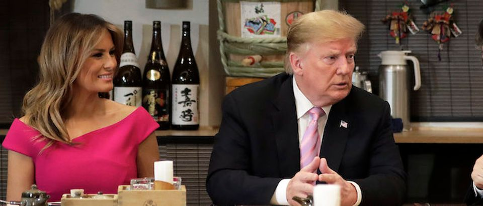 President Donald Trump, second left, speaks with Shinzo Abe, Japan's Prime Minister, second right, while sitting at a counter with First Lady Melania Trump, left, and Akie Abe, wife of Shinzo Abe, during a dinner at the Inakaya restaurant in the Roppongi district on May 26, 2019 in Tokyo, Japan. (Photo by Kiyoshi Ota -Getty Image)