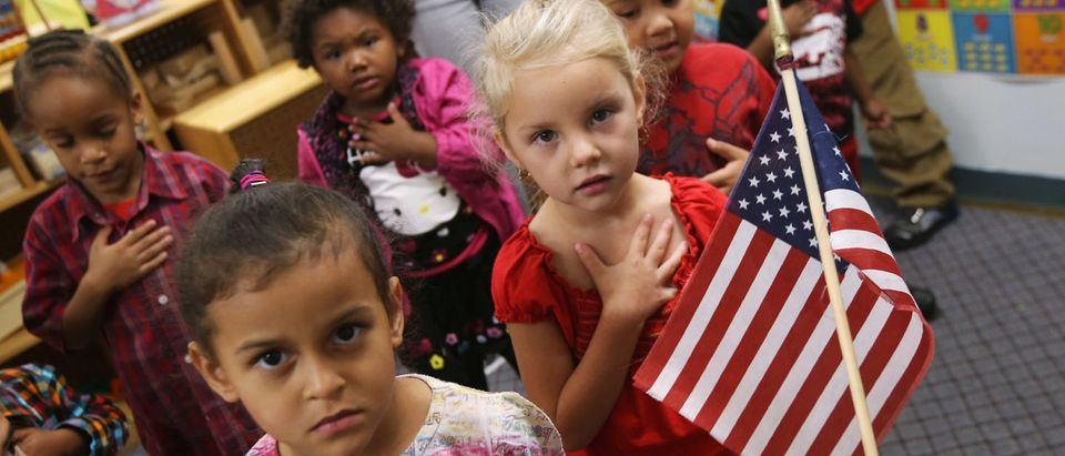 Children recite the Pledge of Allegiance at the beginning of the school day at the federally-funded Head Start school on Sept. 20, 2012 in Woodbourne, New York. (Photo by John Moore/Getty Images)