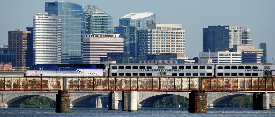 A Virginia Railway Express commuter train passes over the Potomac River in Washington (Joshua Roberts/Reuters)