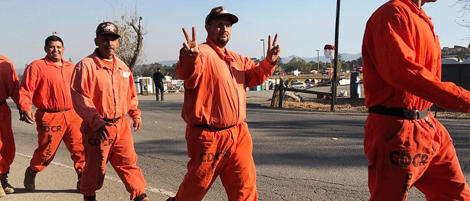 Prison inmates head out to the days work of battling the blazes at fire command center in Santa Rosa