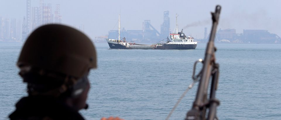 A U.S. Navy soldier onboard Mark VI Patrol Boat stands guard as an oil tanker makes its way towards Bahrain port, during an exercise of U.S./UK Mine Countermeasures (MCMEX) taking place in Arabian Sea, Bahrain September 11, 2018. REUTERS/Hamad I Mohammed.