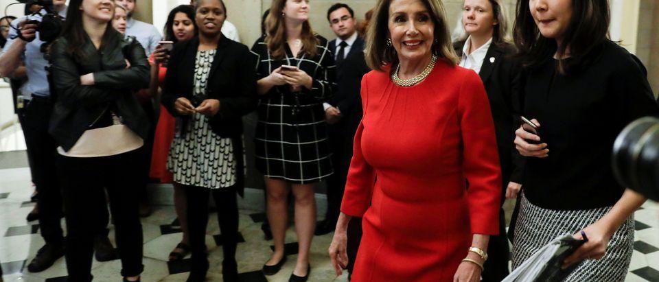 Speaker of the House Pelosi walks through Statuary Hall at the U.S. Capitol in Washington