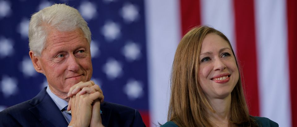Former U.S. President Bill Clinton and Chelsea Clinton listen as U.S. Democratic presidential nominee Hillary Clinton speaks at a campaign rally in Raleigh, North Carolina, U.S. November 8, 2016. REUTERS/Brian Snyder