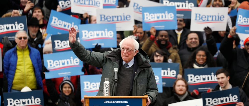 Supporters wave signs ahead of a rally by U.S. Presidential Candidate and Vermont Senator Bernie Sanders in New York