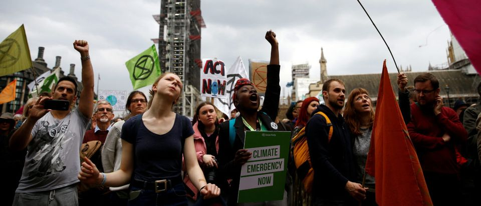 Climate change activists from the Extinction Rebellion protest at the Parliament Square in London