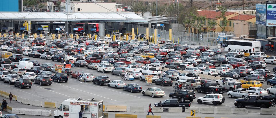 Cars wait to cross at San Ysidro border crossing between the U.S. and Mexico