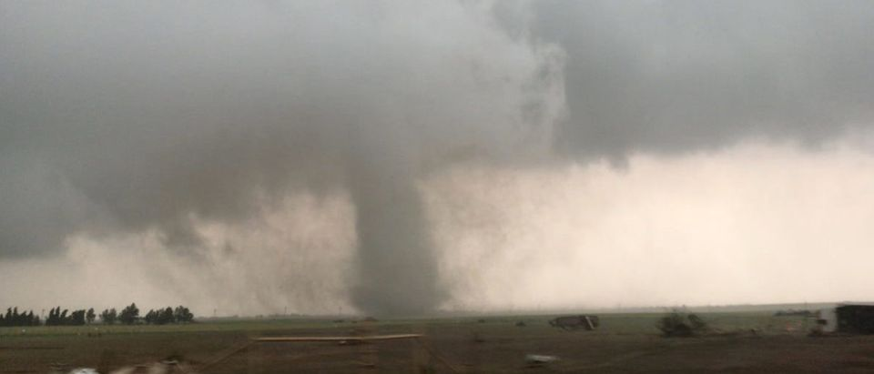 A tornado spins during stormy weather in Mangum, Oklahoma