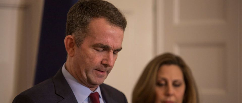 Virginia Governor Ralph Northam, accompanied by his wife Pamela Northam announces he will not resign during a news conference in Richmond, Virginia, U.S. February 2, 2019. Picture taken February 2, 2019. REUTERS/Jay Paul