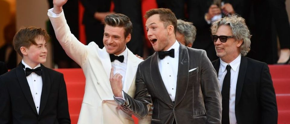 """arrive for the screening of the film """"Rocketman"""" at the 72nd edition of the Cannes Film Festival in Cannes, southern France, on May 16, 2019. (Photo credit: ALBERTO PIZZOLI/AFP/Getty Images)"""