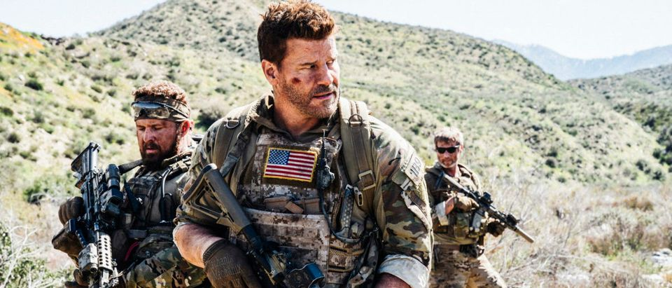 """My Life for Yours"" -- Bravo Team desperately searches for Ray after he gets separated from them while in enemy territory, on SEAL TEAM, Wednesday, May 8 (10:00-11:00 PM, ET/PT) on the CBS Television Network. Series star David Boreanaz directed the episode. Pictured L to R: AJ Buckley as Sonny Quinn and David Boreanaz as Jason Hayes. Photo: Erik Voake/CBS ©2019 CBS Broadcasting, Inc. All Rights Reserved"