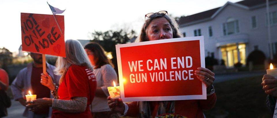 Dozens of people attend a vigil remembering the 59 people killed in Sunday's shooting in Las Vegas and calling for action against guns on Oct. 4, 2017 in Newtown, Connecticut. (Spencer Platt/Getty Images)