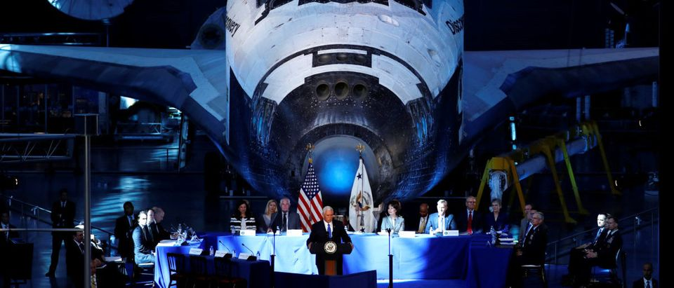 In the shadow of the Space Shuttle Discovery, U.S. Vice President Mike Pence delivers remarks before convening the first meeting of National Space Council at the Smithsonian National Air and Space Museum's Udvar-Hazy Center in Chantilly, Virginia, Oct. 5, 2017. REUTERS/Jonathan Ernst