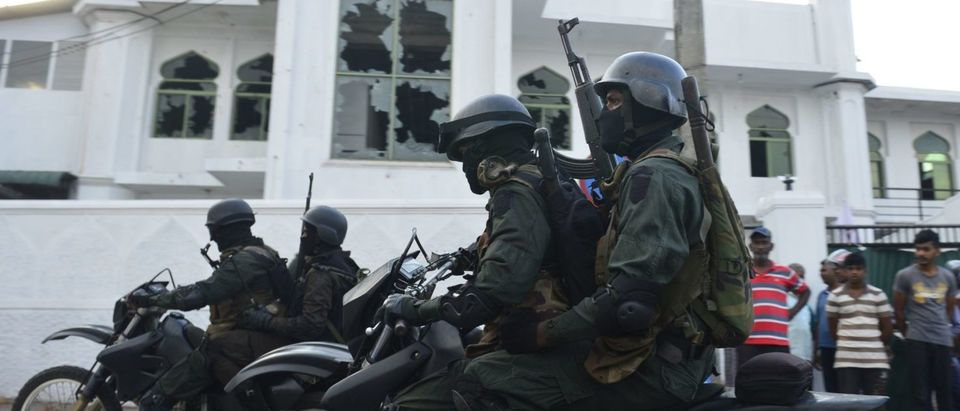 Heavily-armed Sri Lankan soldiers ride a motorcycle in front of the Jumha Mosque after a mob attack in Minuwangida on May 14, 2019. (Photo: LAKRUWAN WANNIARACHCHI/AFP/Getty Images)