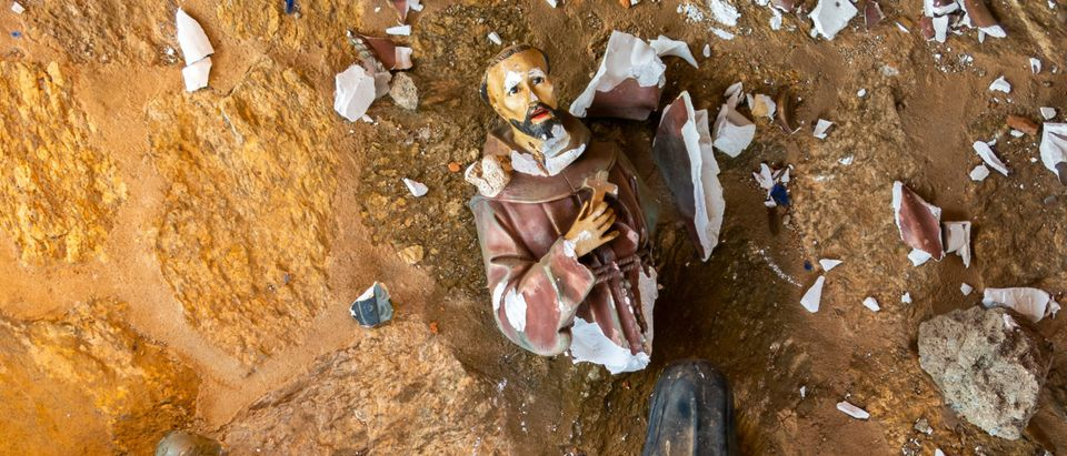 Pictured is a vandalized Catholic statue. (Shutterstock/Tacio Philip Sansonovski)