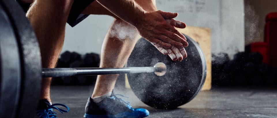 Weight lifter removed from competition.baranq Shutterstock