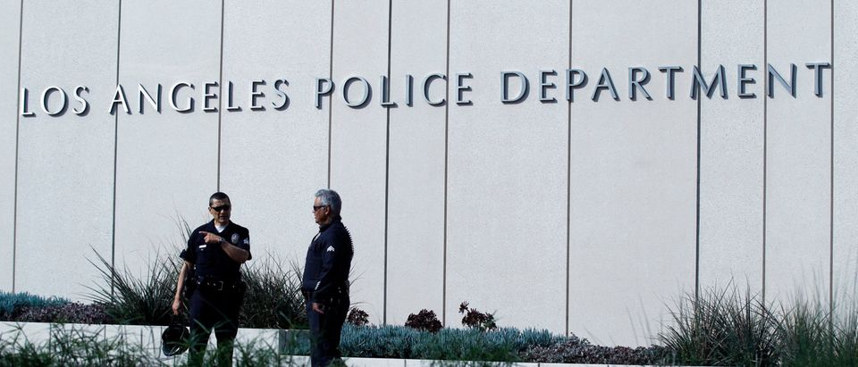 """Police officers patrol outside LAPD headquarters in Los Angeles, California February 7, 2013. Authorities in California launched a statewide manhunt on Thursday for former Los Angeles police officer Christopher Jordan Dorner who threatened """"warfare"""" on cops and was suspected in a shooting spree that has killed three and wounded two others. REUTERS/Mario Anzuoni"""