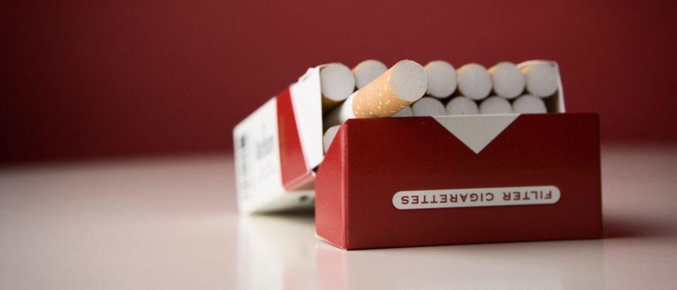 A pack of cigarettes lies open on a counter. Shutterstock image via st.noon