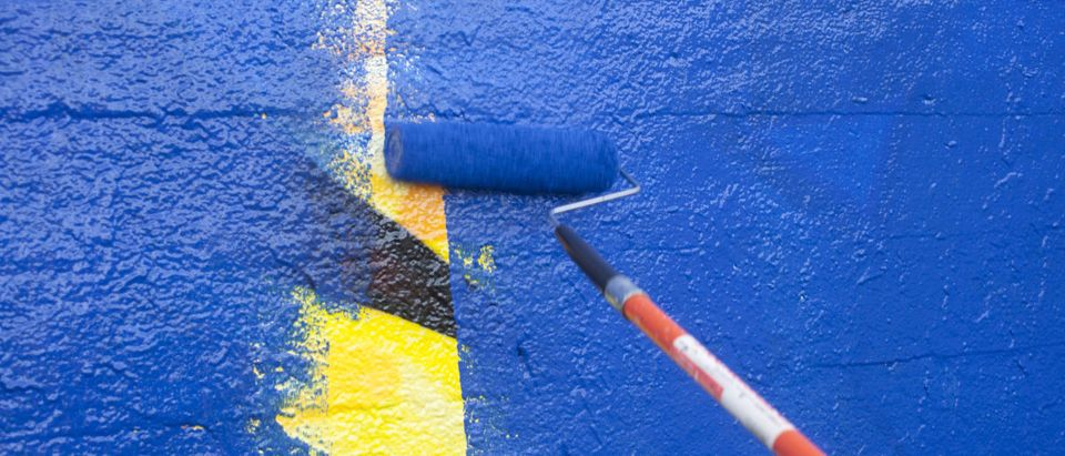 Paint is used to cover up graffiti. Shutterstock via jdwfoto
