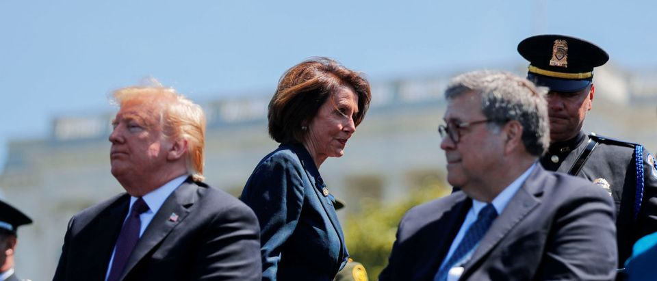 Speaker of the House Nancy Pelosi walks behind U.S. President Donald Trump and U.S. Attorney General William Barr as they all attend the 38th Annual National Peace Officers Memorial Service on Capitol Hill in Washington, U.S., May 15, 2019. REUTERS/Carlos Barria