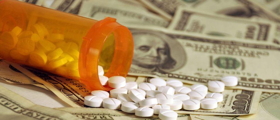 A bottle of prescription drugs is overturned. Shutterstock image via blu fish design