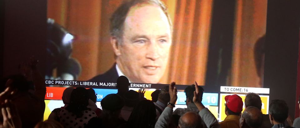 An image of former Canadian Prime Minister Pierre Trudeau is shown on a screen as Liberal Party supporters cheer as they watch results during Canada's federal election in Montreal